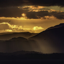 Sunset over mountains<br/>Photo Credit: Alistair Haughton