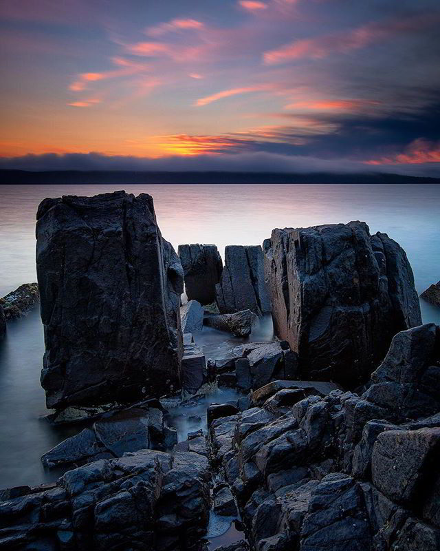 Bruny Island sunset over rocks<br/>Photo Credit: Nathan Goldsworthy<br/>Canon 5D MkIV f13 27mm 30s ISO100
