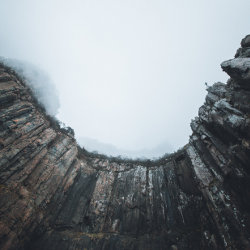 Looking up soaring cliffs